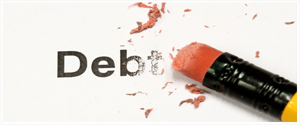"An eraser working hard to erase the word ""debt"""